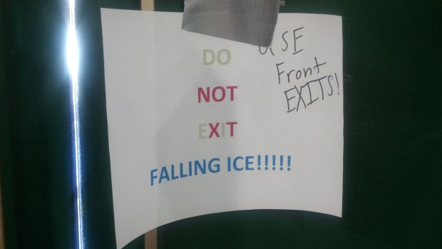Signs like these are posted around campus to warn students of possible falling snow and ice. Photo by Michelle DePinho.