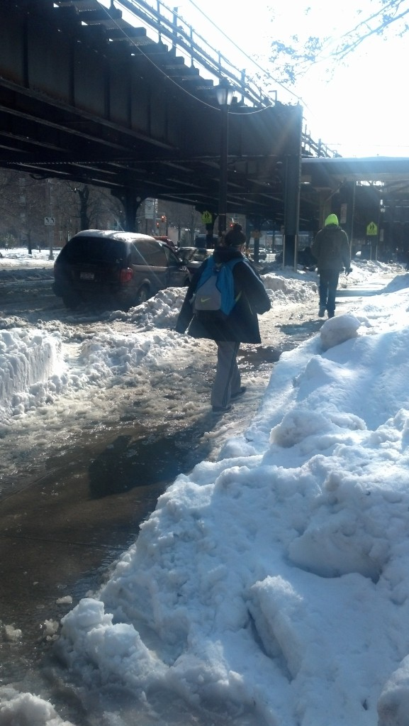 Students trek through snow and ice to get to class on Broadway. Photo by Michelle DePinho.