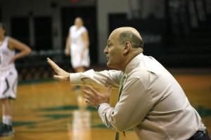 Head Coach John Olenewski directing his team on defense.