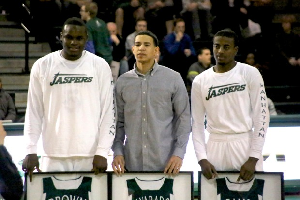 From left to right: Rhamel Brown, Michael Alvarado, and George Beamon - the only Manhattan senior class to have three 1,000 point scorers - pose for a picture as they get honored for their time as Jaspers. Photo taken by James O'Connor