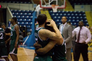 Mike Alvarado and RaShawn Stores, high school and college teammates, share an emotional moment. Photo by James O'Connor.