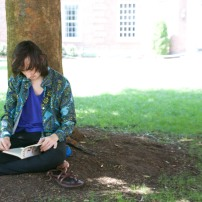 Students enjoy the warm weather and shady spots on campus.