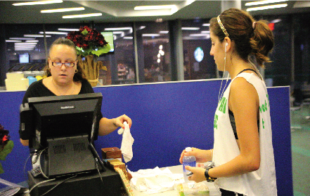 Johanna Petruski buying food at the student commons. Photo by James O'Connor.