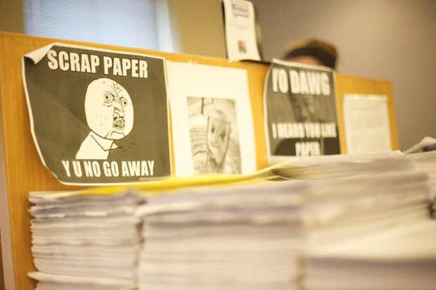 Stacks of wasted paper like these have accumulated in the library. ITS hopes the printing limits will help curb this. Photo by James O'Connor.