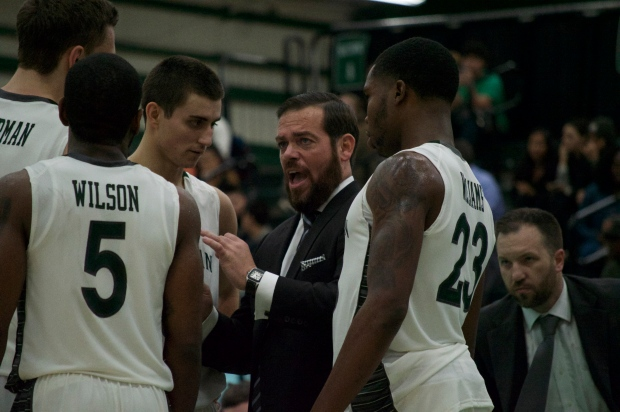 Steve Masiello gives instructions to his team during a timeout. Photo by Kevin Fuhrmann.
