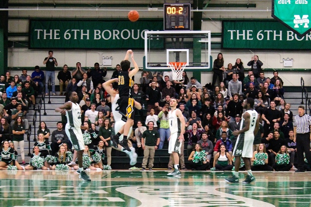 Michael Coffey goes up for what would be the game winner and his eighth 3-pointer of the night. Photo by Kevin Fuhrmann.