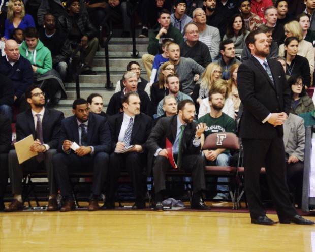 Steve Masiello and his coaching staff can only watch as Manhattan eventually loses to Fordham by 23 points. Photo taken by Jon Reyes.